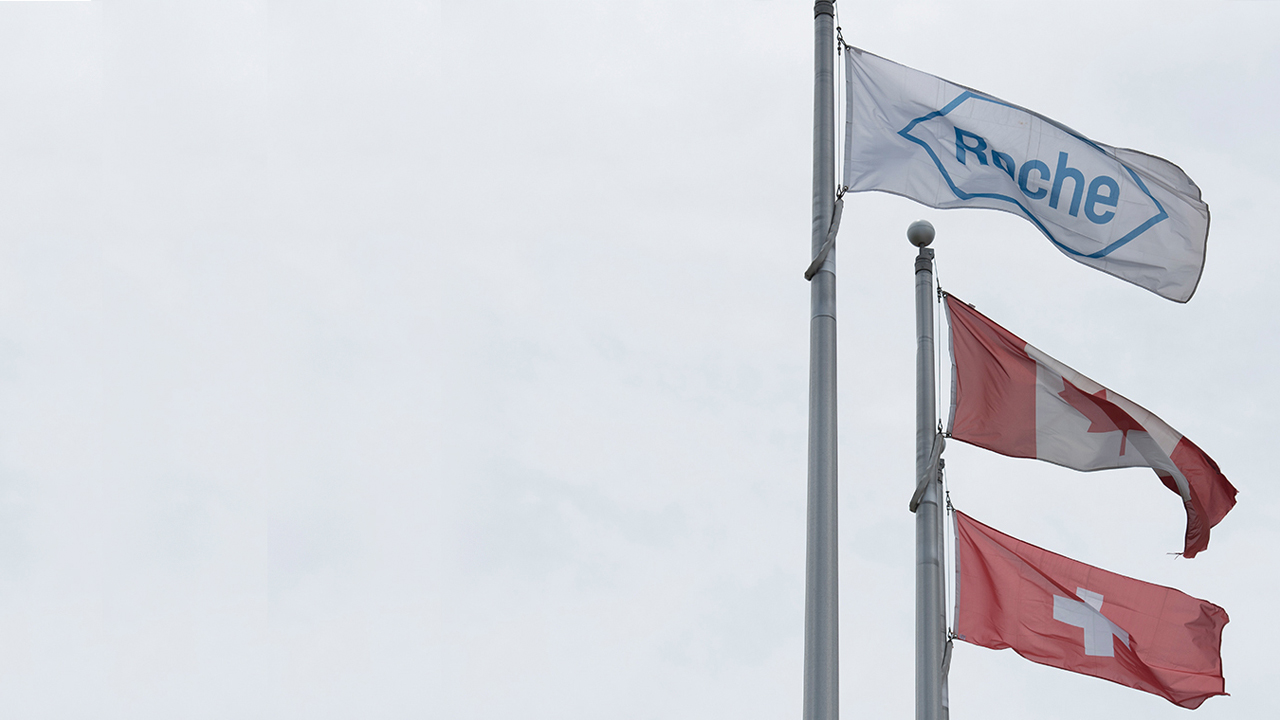 Roche flag flying next to the Canadian and Swiss flags