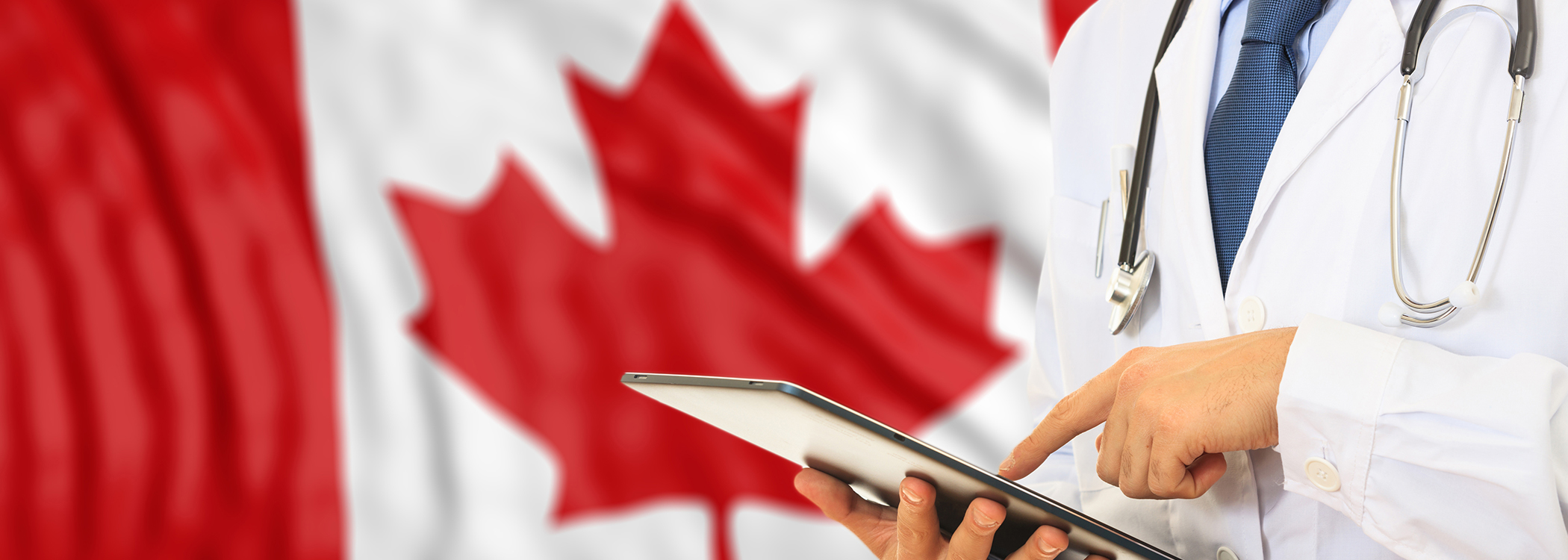 Doctor on tablet with Canadian flag in the background