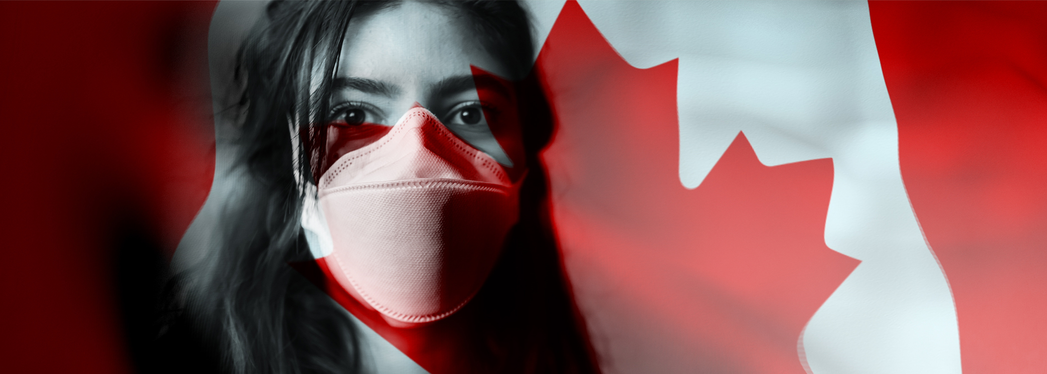 Woman with face mask stands in front of Canadian flag
