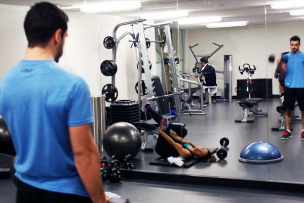 Male and female employees working out in a gym